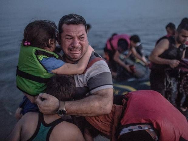 Kos crisis: The story behind the photograph of a Syrian father shared by thousands online - Europe - World - The Independent