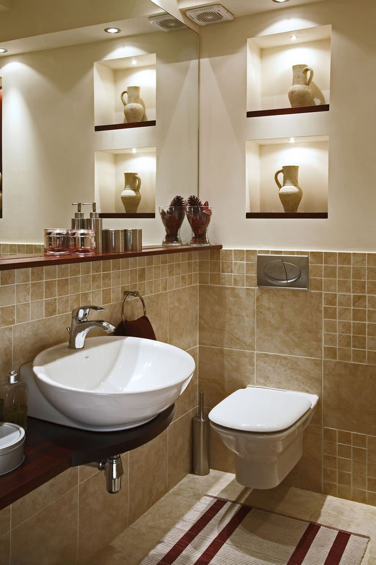 Love the feel of this bathroom. The vases are a great touch. Of course I love the lighting