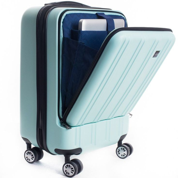Calpak's Wandr carry-on luggage with a special built-in compartment for a laptop, in mint.