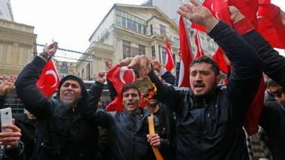 03/12/17   Germany & the Netherlands disallow Turkish Foreign Minister to hold Rallies in their countrys    Supporters of Turkish President Recep Tayyip Erdogan burn a US dollar note as they shout slogans against the Netherlands in front of the Dutch Consulate in Istanbul, Turkey 12 March 2017