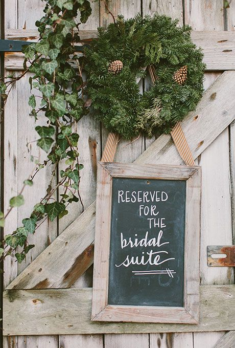 Line the way to your bridal suite with evergreen wreaths and pinecones | Brides.com