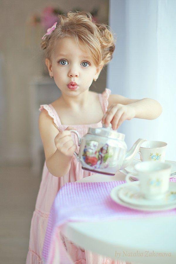 Adorable girl. Adorable dress. Adorable tea party.