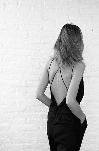 Jumpsuit with crossover at the back. Black outfit. Minimal and classy.
