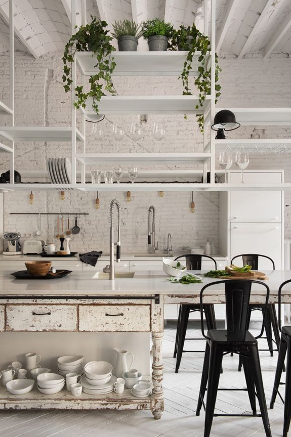 There are plenty of beautiful apartments on the internet to drool over, but  this one takes the cake. With minimalist decor and white brick walls, this  urban abode is boasting with timeless style. We're swooning over the rustic  kitchen and the stand-alone bathtub in the bedroom! What's your favorite  part about this perfect apartment?