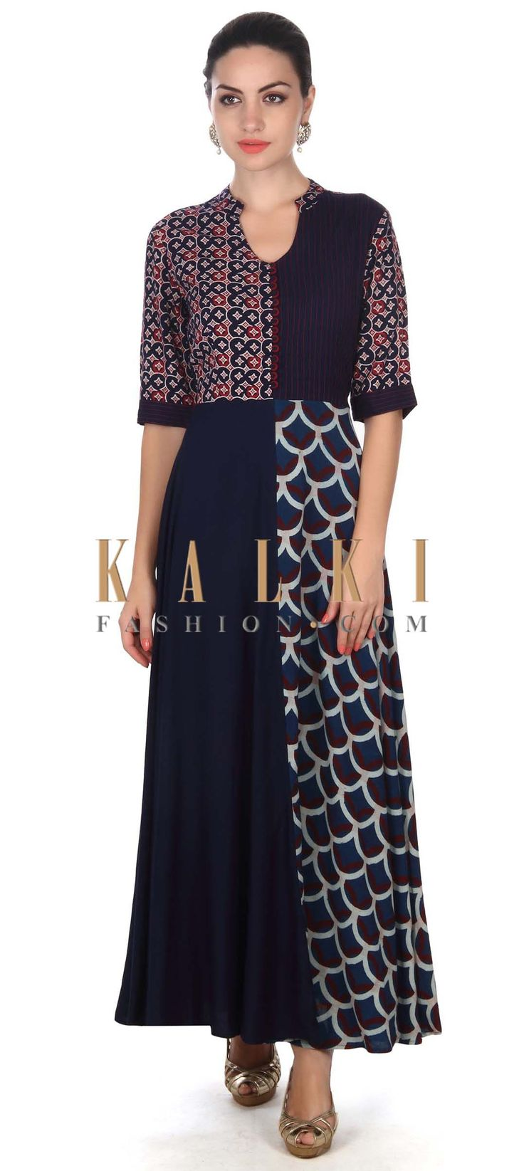 By this Navy blue dress adorn in print and thread only on Kalki