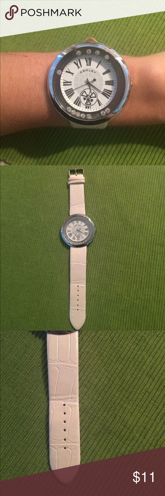 """Large Face Watch w/white patent band Face = 2in diameter Wristband width = 7/8 of an inch. Band is patent white with Textured pattern. Crystals """"swirl"""" around watch face with movement of wrist. Roman numerals. Stainless steel back. **needs battery** excellent Condition Accessories Watches"""