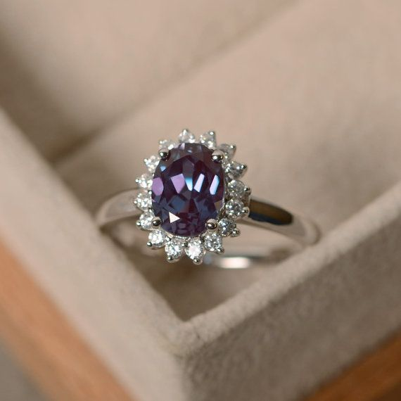 This is everything https://www.etsy.com/listing/278660806/oval-cut-alexandrite-ring-halo-ring