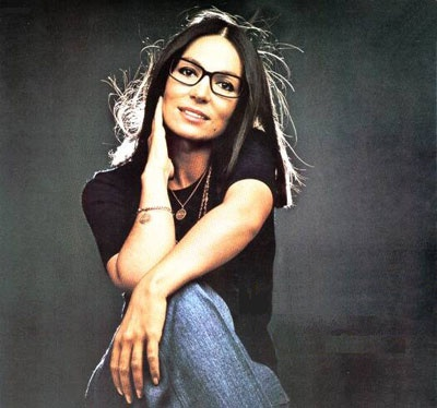 The simplest solution for hiding under eye bags and dark circles: eye glasses!    Greek singer Nana Mouskouri made eye glasses her signature.