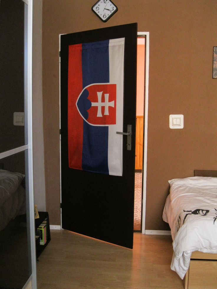 White door-frame with flag and brown wall color #slovakia #door #decoration #bedroom