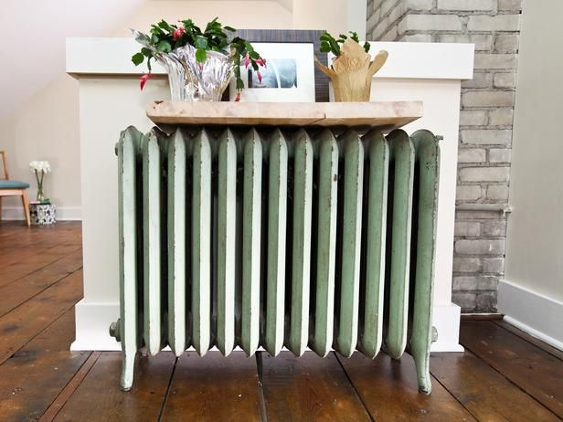 As seen on Rehab Addict...Since the old heating system was ripped out, this cast iron radiator was converted into a shelf to commemorate the original structure.