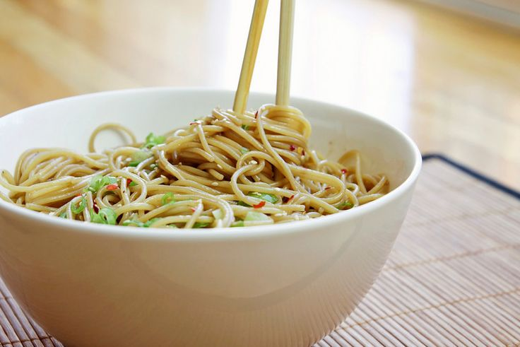 Easy Sesame Noodles  Ingredients  12 ounces thin spaghetti  ¼ cup soy sauce  2 tablespoons sugar  3-4 cloves garlic, minced  2 tablespoons rice vinegar  2 tablespoons sesame oil  ½ teaspoon hot chili oil  4 tablespoons olive oil  2 tablespoons hot water  3-4 green onions, sliced