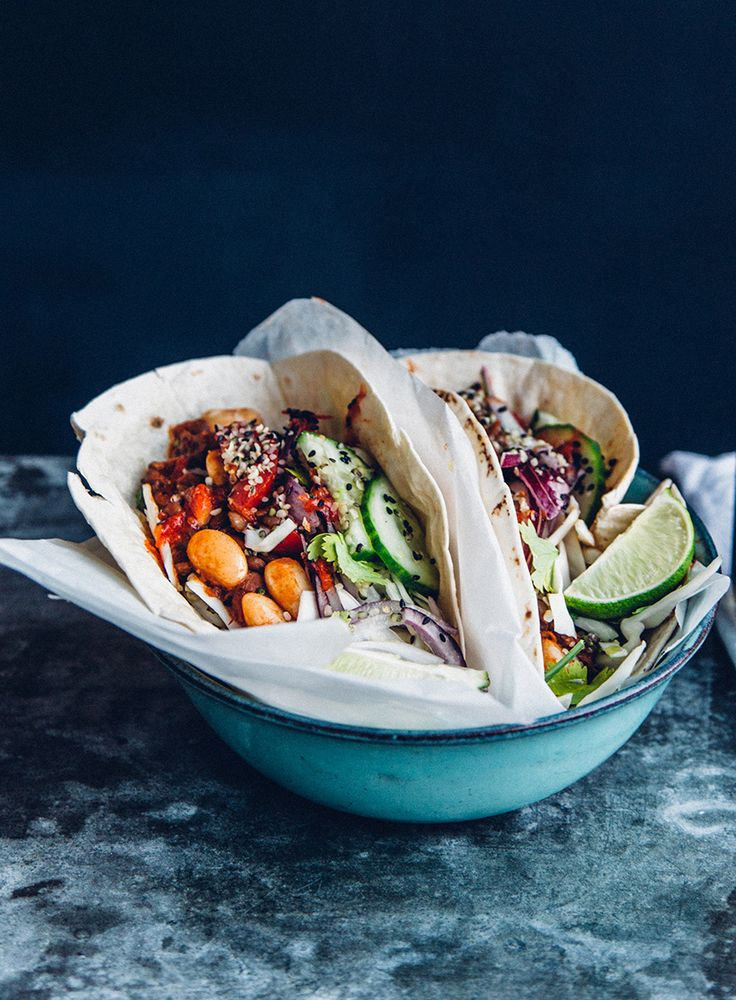 A little pinch of raw cacao powder makes a delicious addition to the warm beans in these glorious vegan tacos.