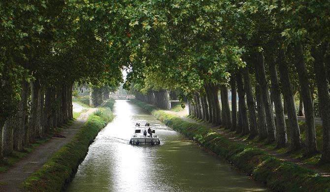 The Canal du Midi (Occitan: Canal de las Doas Mars, meaning canal of the two seas) is a 241 km (150 mi) long canal in Southern France (French: le Midi). It was ... Get more information about the Canal du Midi on Hostelman.com #attraction #France #world heritage site #travel #destinations #tips #packing #ideas #budget #trips