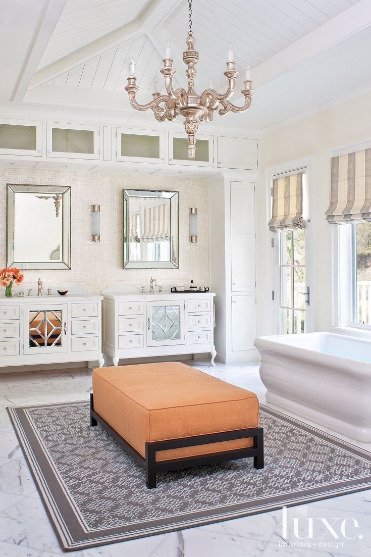 Calacatta marble floors and a mother of pearl wallcovering for Master bathroom ottoman