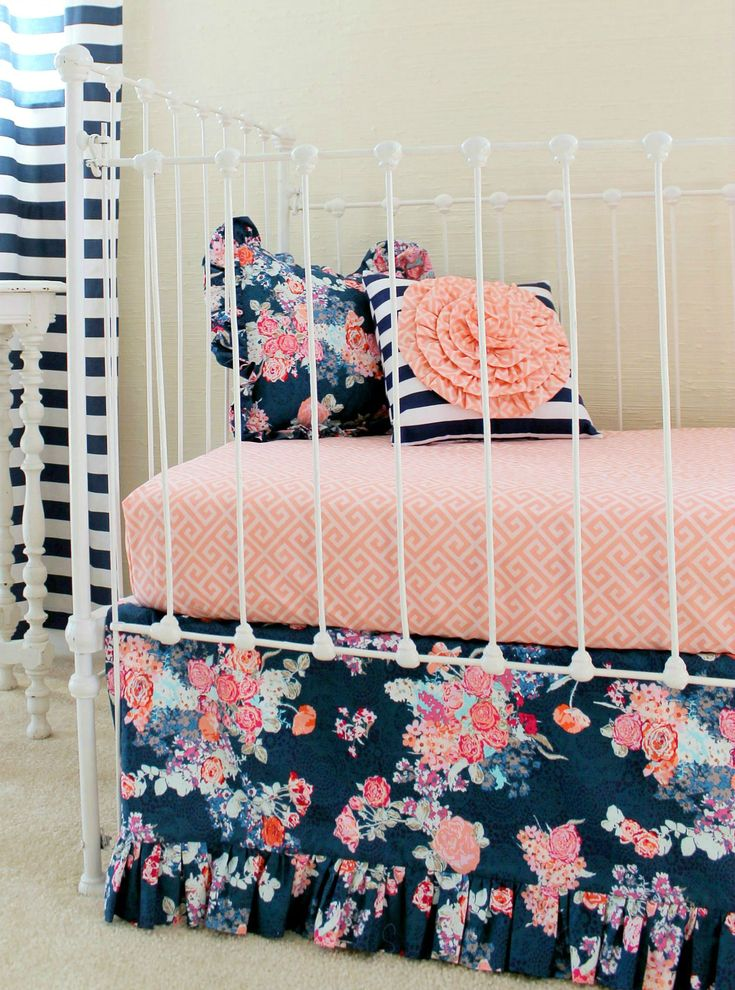 This bold navy and coral bedding by @lottiedababy is sure to make a great statement in your little's nursery! #PNpartner