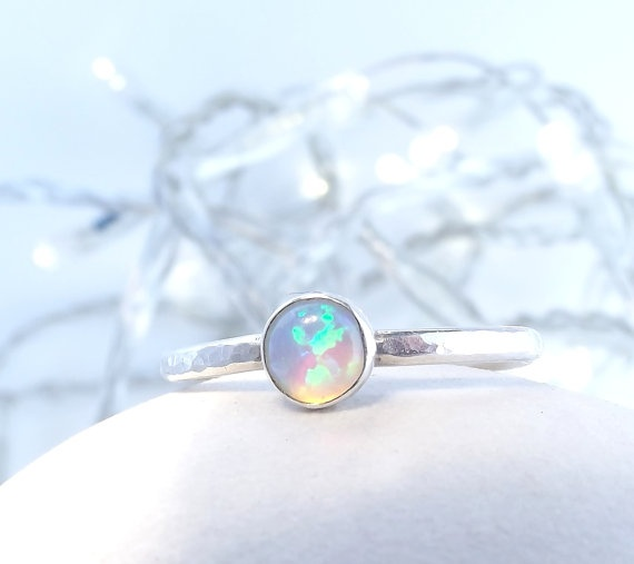 Rainbow Moonstone Ring (If you're curious look up the meanings behind these rings, rainbow ms rings apparently diffuse negativity and ease emotional trauma) :3