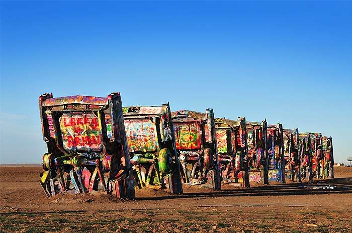 Cadillac Ranch, near Amarillo, Texas    The Cadillac Ranch is a classic landmark beside Route 66. It consists of ten Cadillac cars which are half buried nose-down in the ground in a single file. This public art is the work of the Ant Farm and was created in 1974. The landmark is on the south side of Interstate 40, just 10 miles southwest of Amarillo. It is free of charge and open 24⁄7.