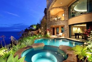 Mediterranean Hot Tub with French doors, Glass railing system, Exterior stone archway, Waterfront, Pool lights, Arched window