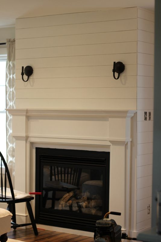 this combined with a simpler mantel and builtin bookshelves
