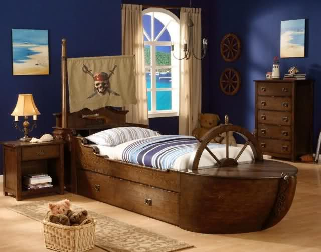 pirate ship bed and the dark blue walls