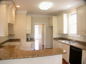 Southern style kitchen. White cabinets and granite countertops, sleek appliances. Remodeled in Raleigh, NC