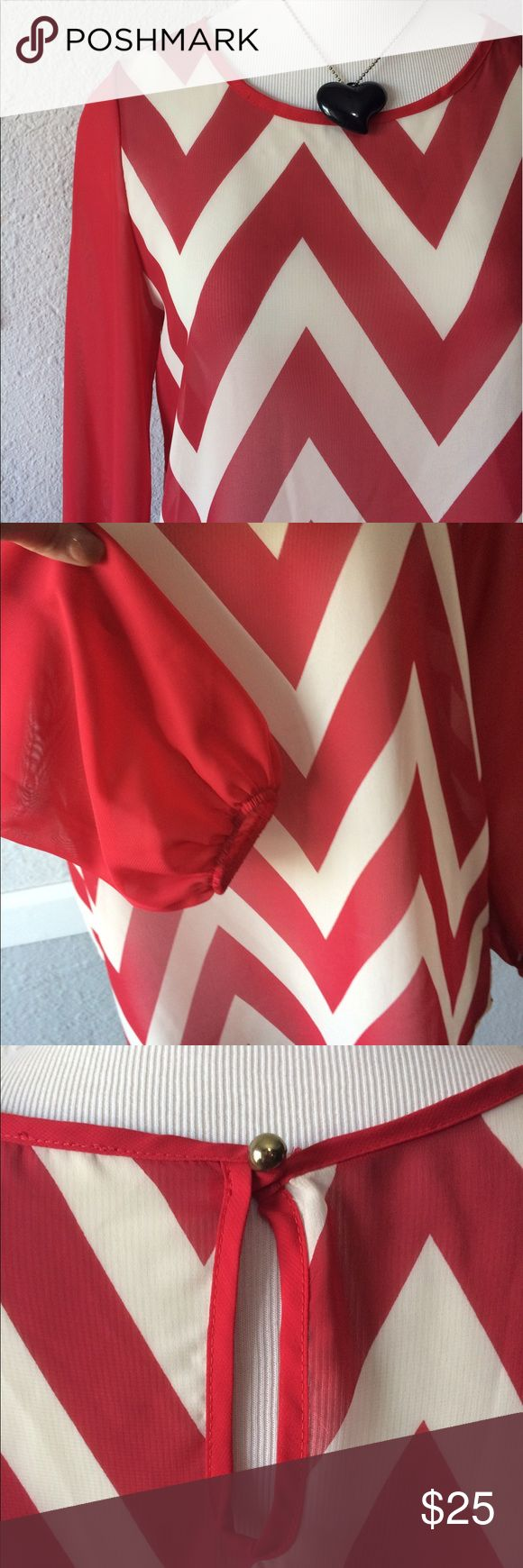 Fun Red Chevron Blouse Medium Like new key hole back. Semi sheer. Elastic wrists. Because this is pretty sheer my sister cut the tags out.. she normally wears a medium boutique Tops Blouses