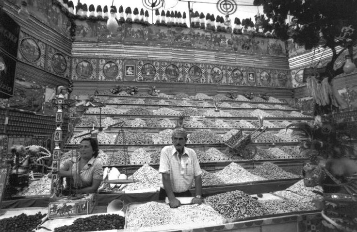 """Ferdinando Scianna  Italy, Sicily, Bagheria:The """"caliaro"""" shop, seller of salted seeds in the San Giuseppe's festival.  © Ferdinando Scianna/Magnum Photos"""
