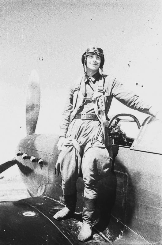 Soviet pilot standing on the wing of the Yak-1
