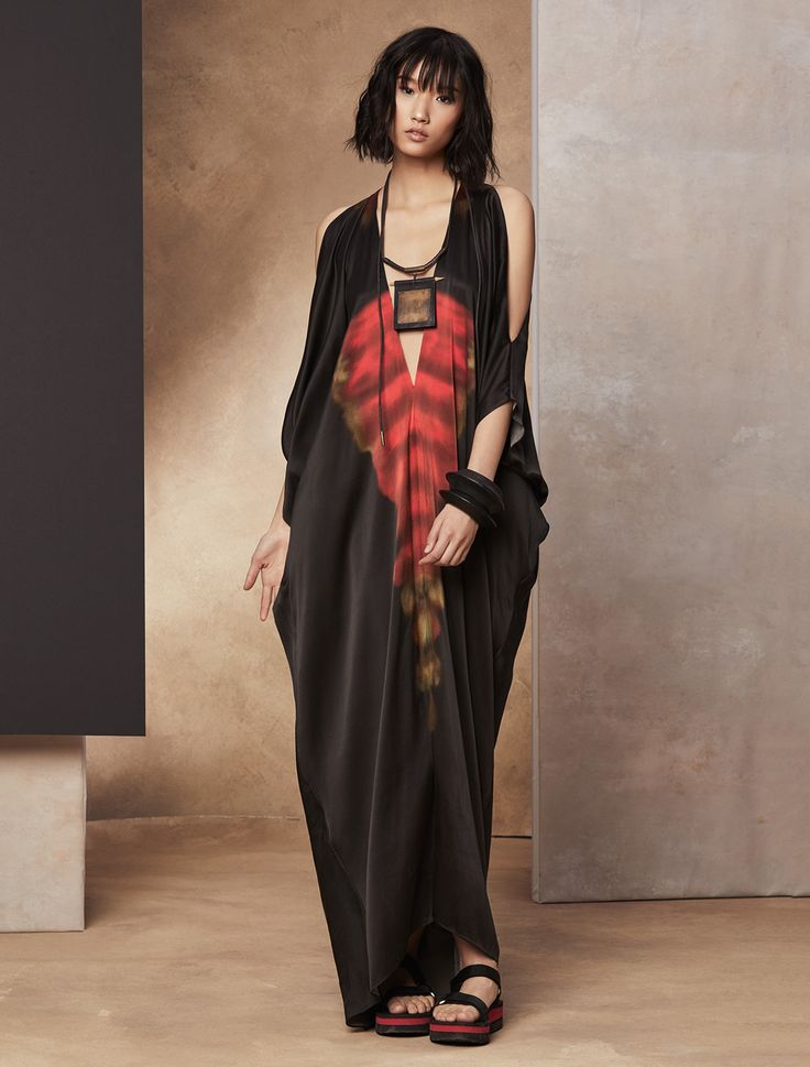Introducing our latest journey, the Silk Road Collection for SS17. Our block printed silk kimono dress is enriched with inspired details. True to the Donna Karan's sensibility, it shows off the shoulders while flattering the form with long, linear details throughout the fabric.