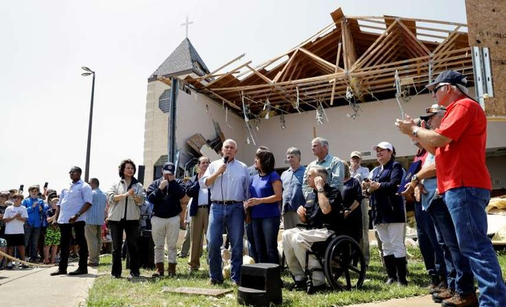 Vice President Mike Pence, center, with his wife Karen, right, speaks to encourage residents affected by Hurricane Harvey during a visit at the First Baptist Church, Thursday, Aug. 31, 2017, in Rockport, Texas.