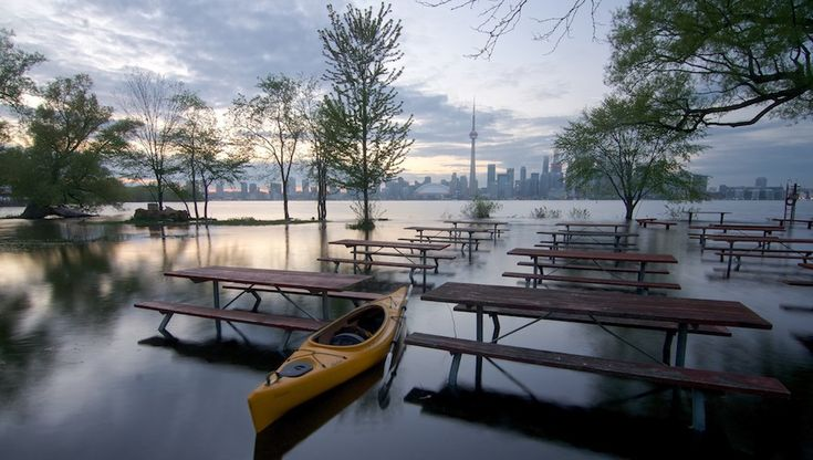 A local photographer headed out to Toronto Island in a kayak to capture their current state after weeks of heavy rain and flooding.