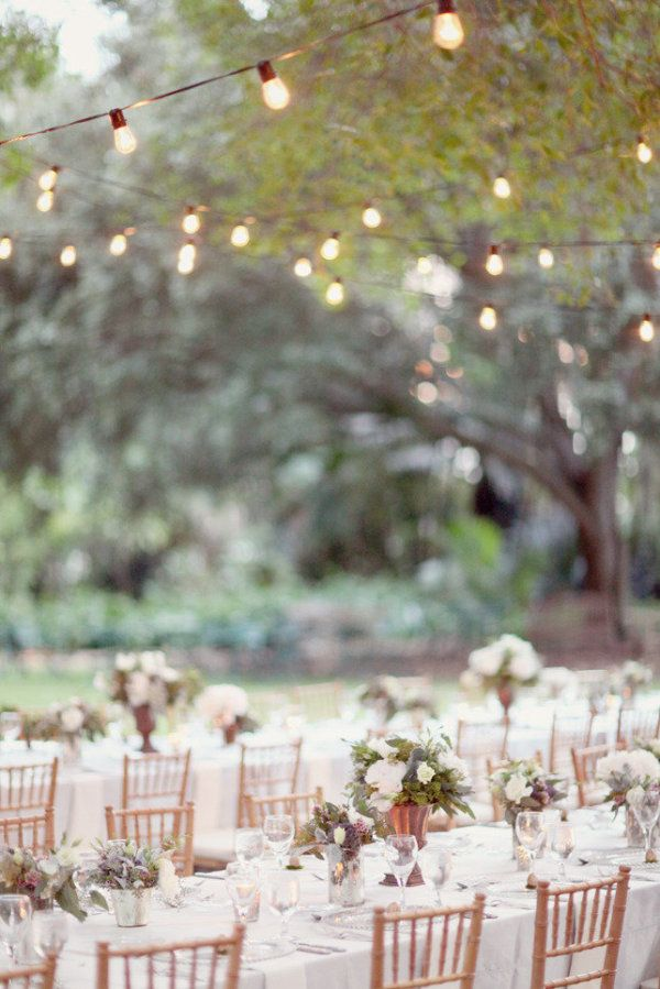 dining alfresco under a canopy of cafe lights. is there anything better?  Photography by http://simplybloomphotography.com, Floral Design by http://srqeventdesigns.com