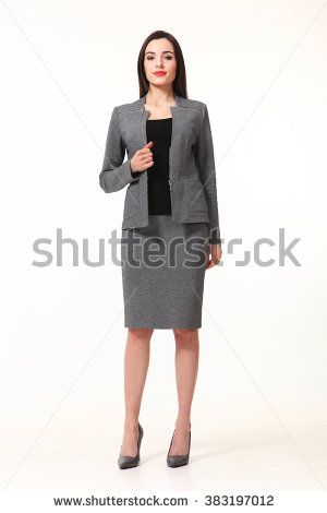 indian asian eastern brunette business executive woman with straight hair style in two pieces jacket and skirt suit   high heels shoes full length body portrait standing isolated on white
