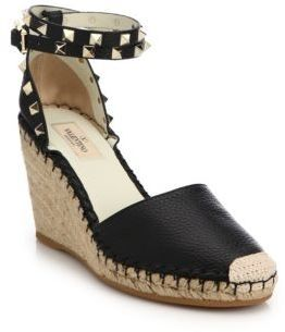 "Pebbled leather espadrille wedge with studded trimEspadrille wedge heel, 3.5"" (90mm)Studded leather upperWraparound ankle-wrap strapLeather liningRubber solePadded insoleMade in Spain"
