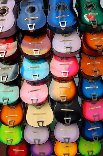 Guitars Rainbow - Crayola crayons aren't this gorgeous! One of my colorful #favorite MOST POPULAR RE-PINS photos: Quite a creative idea that required a lot of work by the photographer to overlay 28 big body instruments just right in columns.  # DdO:) - https://www.pinterest.com/DianaDeeOsborne/instruments-for-joy/ - INSTRUMENTS FOR JOY! Lovely wall of acoustic stringed instruments with pretty sound hole rosettes. PHOTO SOURCE: Flickr.: