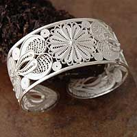 Filigree sunflowers of shining silver bloom in a bracelet filled with beauty and light. By Peru's Alfredo Inga, it is wonderfully delicate and feminine.