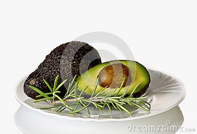 Fresh avocado on white plate, close up.