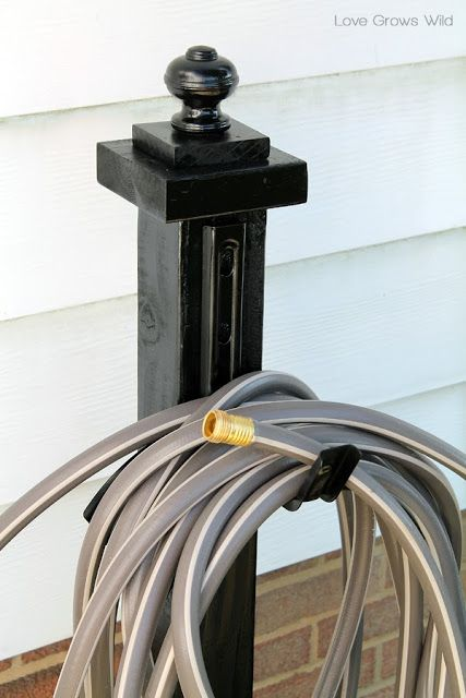 Make this DIY Garden Hose Holder to add great curb appeal to your home! No more tangled piles of hose!