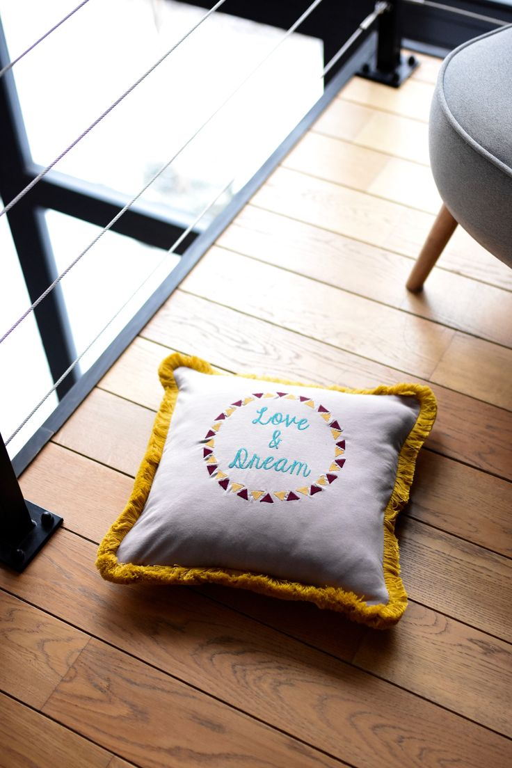 Cushion interior decoration. Tassels, embroidery and soft jersey cotton in pillow case  by NUKI