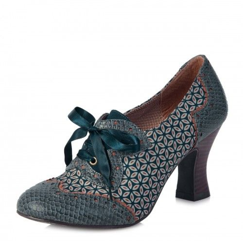 Ruby Shoo Daisy women's shoes combine a modern mix of fabrics with a unique vintage look. The heeled brogue shoe features abstract floral print fabric with mock-croc overlay panels at the toe and heel, complete with an orange colour scallop trim. The stylish teal satin ribbon laces take centre stage with a teal faux suede backdrop and a stunning butterfly shape appliqué.  Ruby Shoo Daisy shoes also boast a wood effect fluted high heel, brogue style detailing and a polka dot fabric shoe li...
