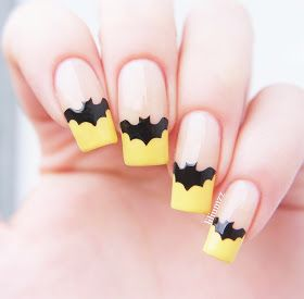 The classic French manicure with a Halloween/ Batman twist!  I've seen versions of this design around where people have used a bat to hid...