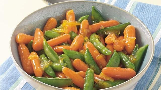 Orange-Glazed Carrots and Sugar Snap Peas - This veggie medley is jazzed up with a zesty glaze of orange marmalade for a fresh-as-can-be tasty side dish.