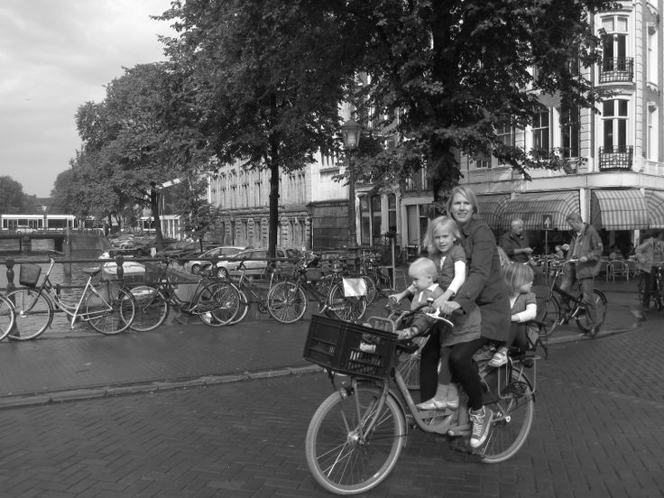 Mom and Kids on Bike  By Camilo Díaz