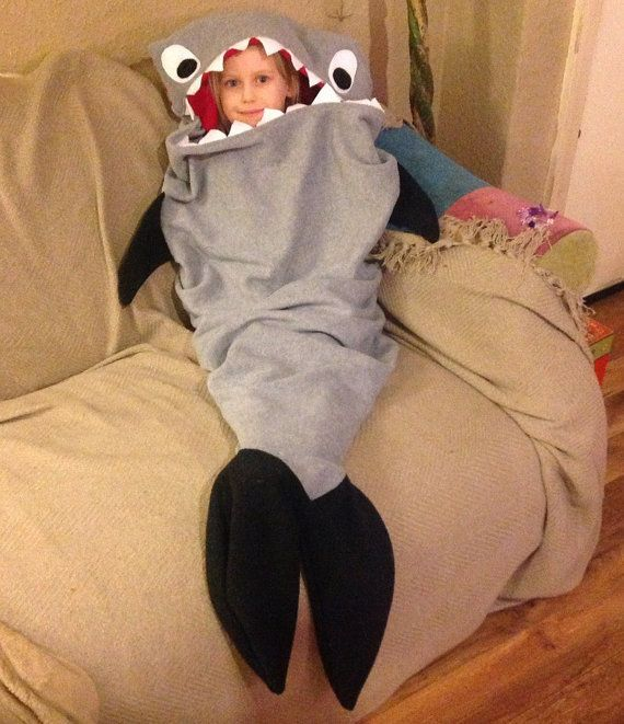 A shark blanket you can snuggle inside, made from a warm anti-pil fleece with a slight hooded head to put over yourself for extra coziness.