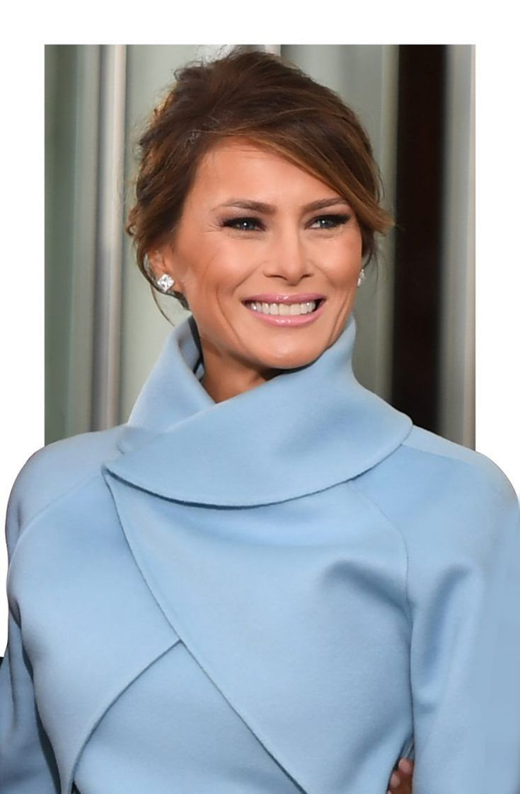 Melania Trump, opting for a classic updo, strikes a pose on the morning of the inauguration.  Melania Trump is know for her signature loose wavy hairstyle, but she chose to switch things up for Inauguration Day.  Spotted leaving Blair House with her husband, President Donald Trump, FLOTUS was wearing