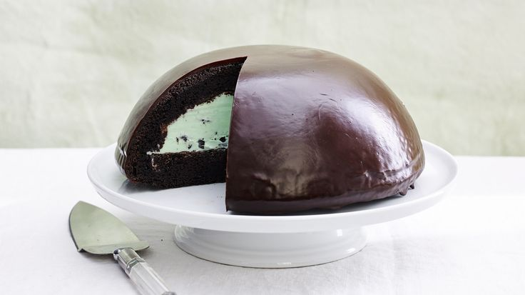 Our grown-up ice cream cake is baked in a heatproof bowl, then hollowed out and filled with mint-chocolate-chip ice cream -- and finished with a crisp, shiny chocolate shell.