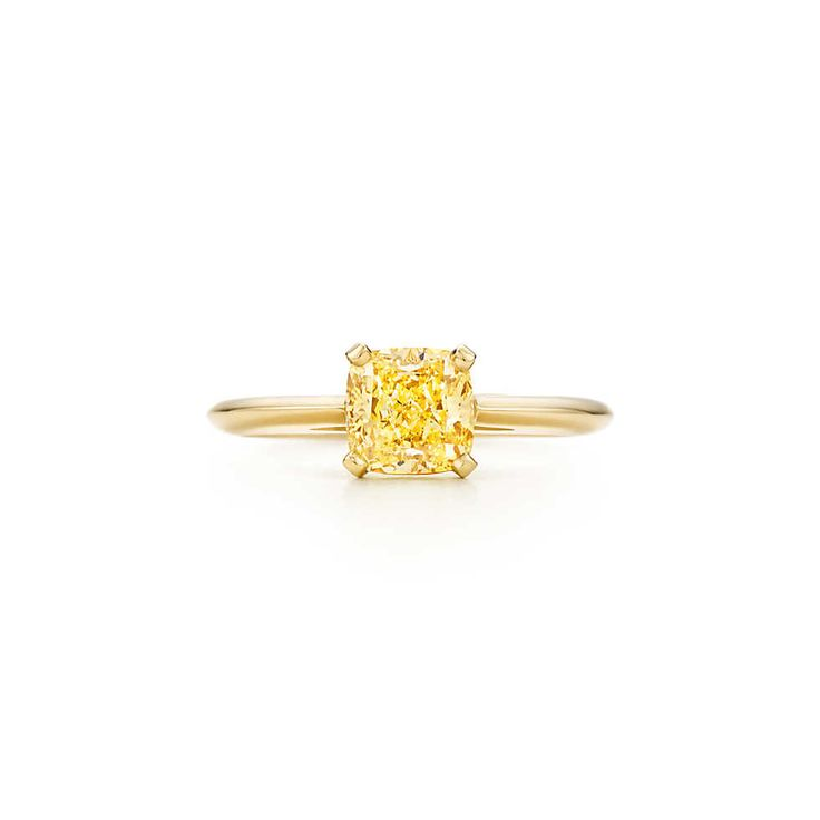 Ring in 18k gold with a cushion-cut yellow diamond.  Great alternative to the Soleste Engagement ring