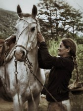 Tammy saddles her horse