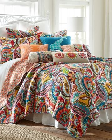 Paisley Luxury Quilt Collection - Update your bedding ensemble with the Rhapsody luxury quilt featuring a colorful paisley pattern with vermicelli stitching. Reverses to a coordinating print.