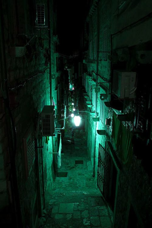 the darkness of the narrow streets at night attracts